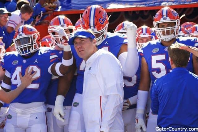 Florida Gators head coach Dan Mullen and the team enter the Swamp before Idaho-1280x852