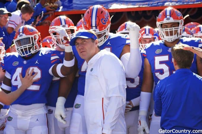 Florida Gators head coach Dan Mullen and the team enter the Swamp before Idaho-1280x852