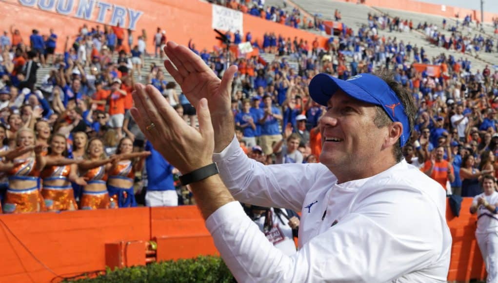 Florida Gators head coach Dan Mullen does the Gator Chomp after South Carolina- 1280x852