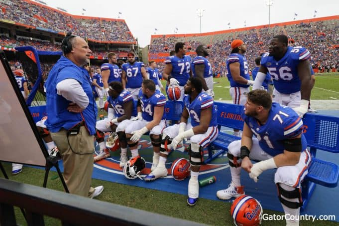 Florida Gators offensive line coach John Hevesy talks to the offensive line- 1280x852
