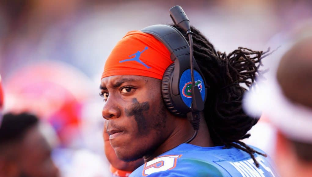 University of Florida quarterback Emory Jones on the headset with quarterback coach Brian Johnson during a win over Idaho- Florida Gators football- 1280x853