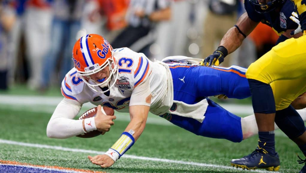 Florida Gators quarterback Feleipe Franks dives for a touchdown against Michigan-1280x853