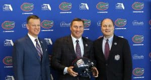 University of Florida athletic director Scott Stricklin and Dan Mullen pose with peach Bowl CEO and President Gary Stokan- Florida Gators football- 1280x1074