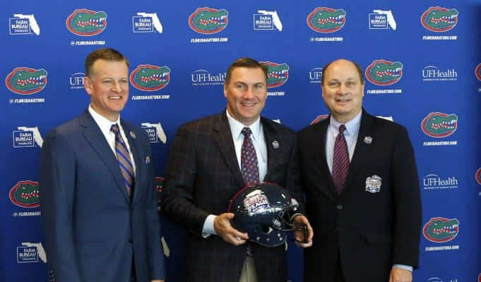 University of Florida athletic director Scott Stricklin and Dan Mullen pose with peach Bowl CEO and President Gary Stokan- Florida Gators football- 1280x1074