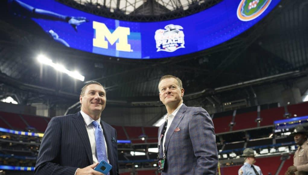 University of Florida football coach Dan Mullen and UF Athletic Director Scott Stricklin talking on the field before the 2018 Peach Bowl- Florida Gators football- 1280x852
