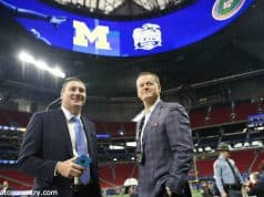 University of Florida football coach Dan Mullen and UF Athletic Director Scott Stricklin talking on the field before the 2018 Peach Bowl- Florida Gators football- 1280x852