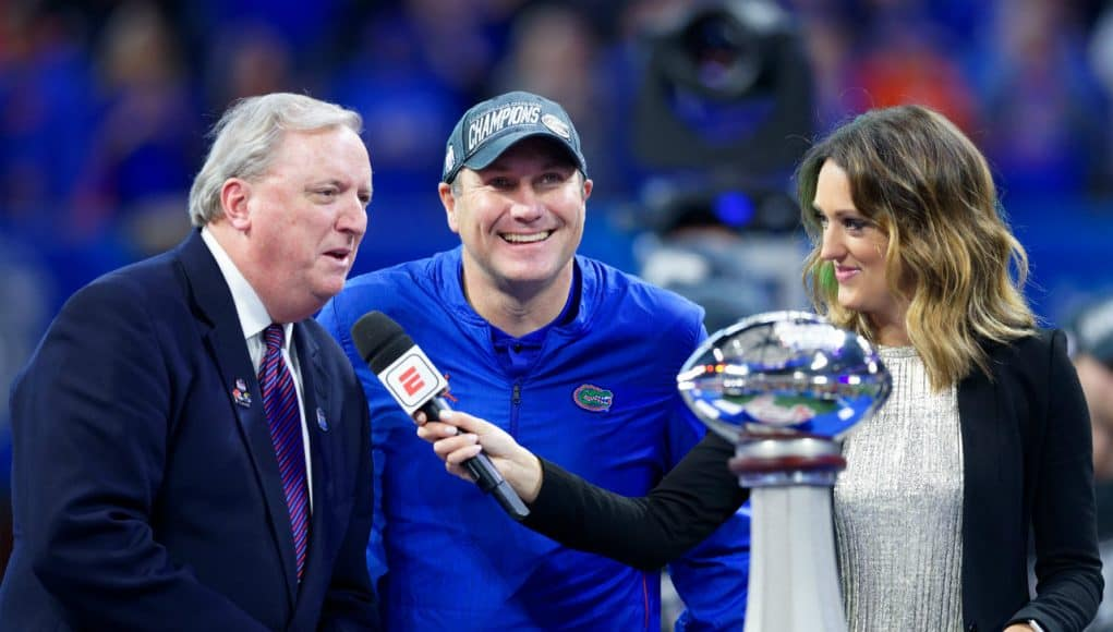 University of Florida head coach Dan Mullen accepts the Chick-fil-A Peach Bowl trophy after the Gators' 41-15 win over Michigan- Florida Gators football- 1280x853
