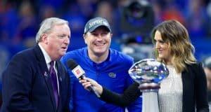 University of Florida head coach Dan Mullen accepts the Chick-fil-A Peach Bowl trophy after the Gators' 41-15 win over Michigan- Florida Gators football- 1280x853