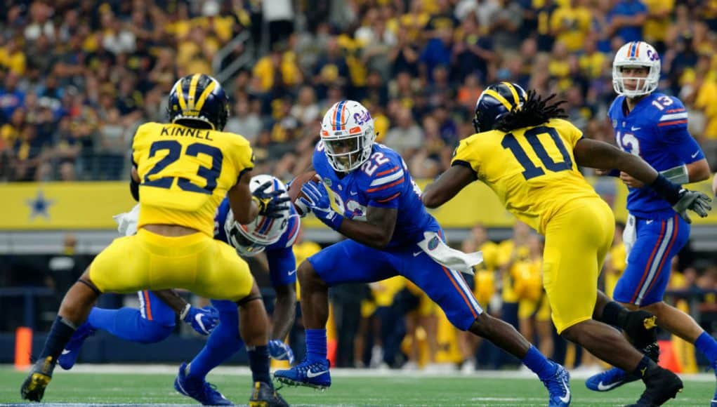 University of Florida running back Lamical Perine carries the ball in the AdvoCare Classic against the Michigan Wolverines- Florida Gators football- 1280x852