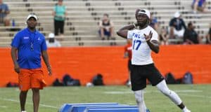 University of Florida quarterback Jalon Jones works out in front of quarterback coach Brian Johnson during Friday Night Lights- Florida Gators football- 1280x853