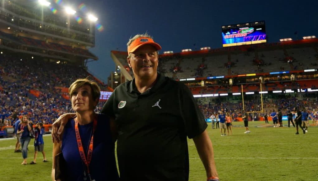 University of Florida defensive coordinator walks off the field with his wife Paige after the Florida Gators win over LSU- Florida Gators football- 1280x852