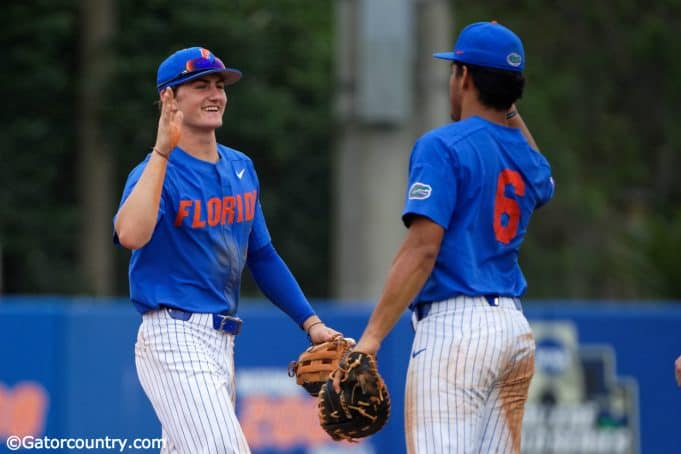 University of Florida freshmen Jud Fabian (left) and Kendrick Calilao (right) celebrate Florida's series clinching win over Miami- Florida Gators baseball-1280x853
