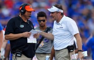 University of Florida defensive coordinator Todd Grantham and head coach Dan Mullen talk over a call in the LSU game - 1280x853