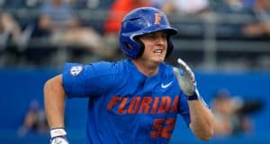 University of Florida junior Kirby McMullen runs out a ground ball against the Miami Hurricanes- Florida Gators baseball- 1280x853