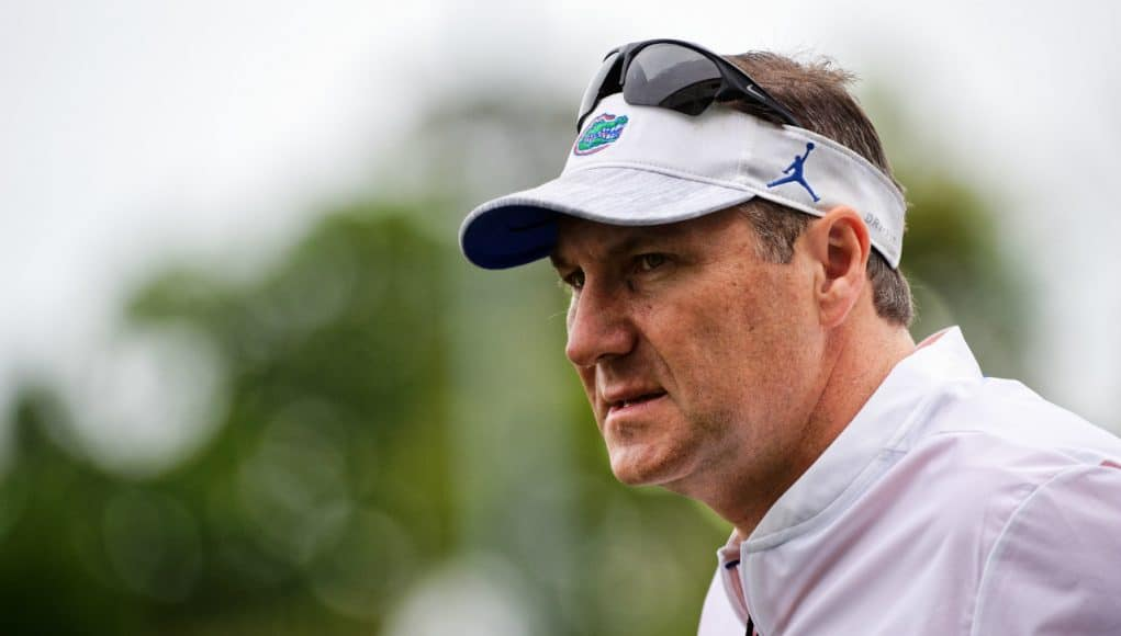 University of Florida head coach Dan Mullen looks on as his team practice during spring camp- Florida Gators football- 1280x853