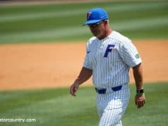 University of Florida manager Kevin O'Sullivan walks back to the dugout after meeting with Christian Scott- Florida Gators baseball -1280x853