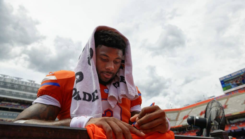 University of Florida running back Lamical Perine signs autographs for fans after the Orange and Blue game in 2019- Florida Gators football- 1280x838