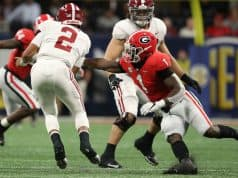 Dec 1, 2018; Atlanta, GA, USA; Alabama Crimson Tide quarterback Jalen Hurts (2) gets by the tackle attempt by Georgia Bulldogs linebacker Brenton Cox (1) in the SEC championship game at Mercedes-Benz Stadium. Mandatory Credit: Jason Getz-USA TODAY Sports