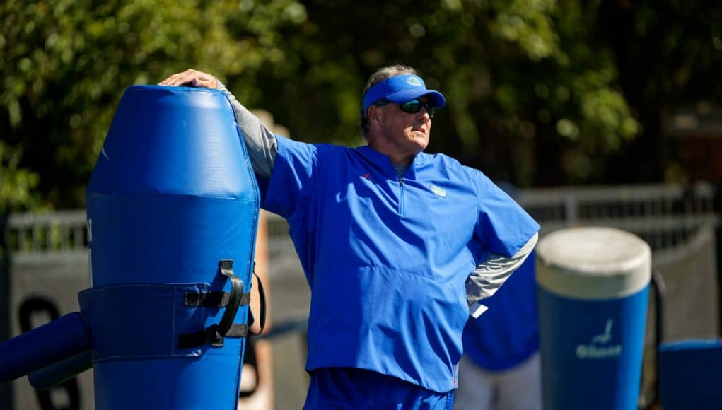 University of Florida defensive coordinator watches as the Florida Gators go through practice in spring camp— Florida Gators football— 1280x854