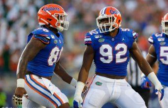 University of Florida defensive linemen Jabari Zuniga and Adam Shuler celebrate one of Florida's 11 sacks against Miami- Florida Gators football- 1280x853