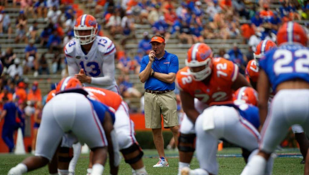 University of Florida head coach Dan Mullen watches as Feleipe Franks calls a play during the 2019 spring game- Florida Gators football- 1280x854