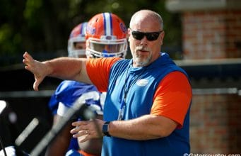 University of Florida offensive line coach John Hevesy teaching before a drill in spring camp- Florida Gators football- 1280x853