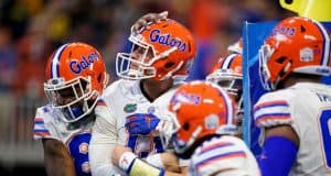 University of Florida quarterback Feleipe Franks is mobbed by teammates after scoring a touchdown against Michigan in the Peach Bowl- Florida Gators football- 1280x853