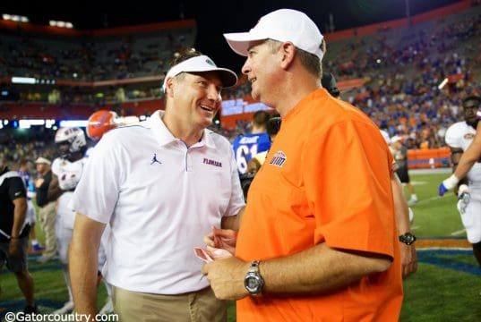 Florida Gators head coach Dan Mullen and UT Martin Skyhawks head coach Jason Simpson post-game handshake- Florida Gators football- 1280x852