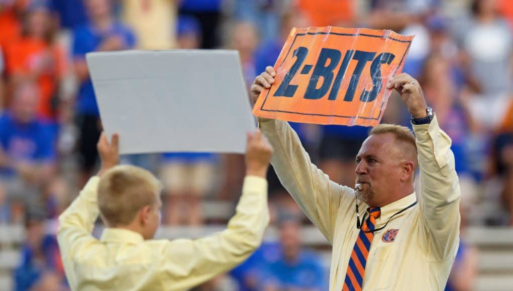 George Edmondson's grandchildren lead Ben Hill Griffin in the Mr. Two Bits cheer in before the Gators' game against UT Martin in honor of their grandfather- Florida Gators football- 1280x853