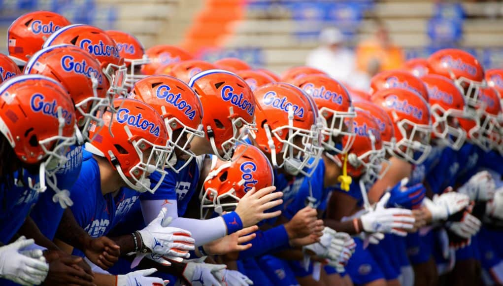 The University of Florida football team locks arms and begins warming up before the Florida Gator game against the Tennessee Volunteers- Florida Gators football- 1280x853