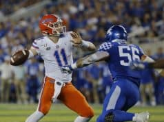 Sep 14, 2019; Lexington, KY, USA; Florida Gators quarterback Kyle Trask (11) passes the ball against the Kentucky Wildcats linebacker Kash Daniel (56) in the 3rd quarter at Kroger Field. Mandatory Credit: Mark Zerof-USA TODAY Sports