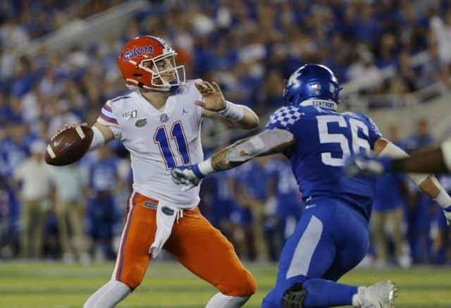 Sep 14, 2019; Lexington, KY, USA; Florida Gators quarterback Kyle Trask (11) passes the ball against the Kentucky Wildcats linebacker Kash Daniel (56) in the 3rd quarter at Kroger Field. Mandatory Credit: Mark Zerof-USA TODAY Sports