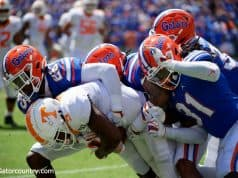 University of Florida defensive players gang tackle a Tennessee receiver in a 34-3 win over the Volunteers- Florida Gators football- 1280x853