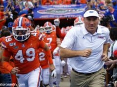 University of Florida head coach Dan Mullen leads the Florida Gators on to the field to take on the Towson Tigers- Florida Gators football- 1280x853