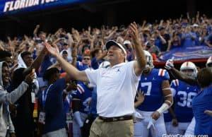 Florida Gators head coach Dan Mullen enters the Swamp before the Auburn game- 1280x853