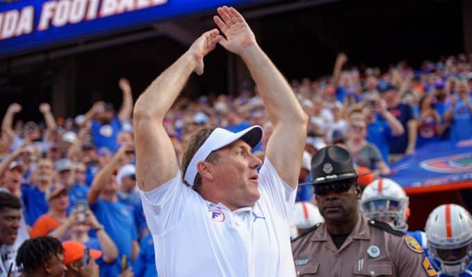 Florida Gators head coach Dan Mullen pumps the crowd before the Auburn game-1280x852