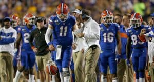 Oct 12, 2019; Baton Rouge, LA, USA; Florida Gators head coach Dan Mullen talks to quarterback Kyle Trask (11) in the first quarter of their game against the LSU Tigers at Tiger Stadium. Mandatory Credit: Chuck Cook-USA TODAY Sports