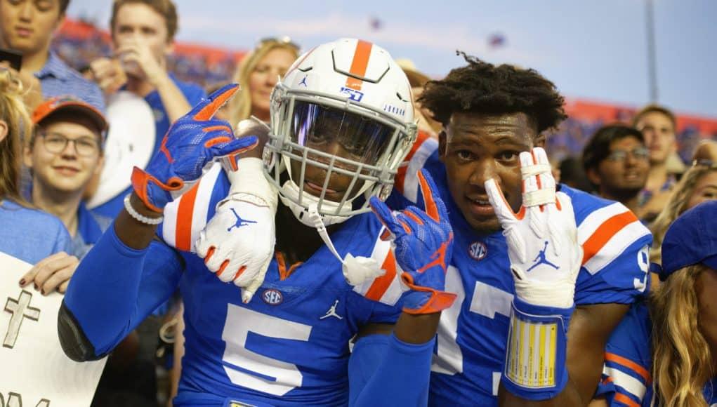 University of Florida freshmen Kaiir Elam and Khris Bogle celebrate with fans after the Gators win over Auburn in 2019- Florida Gators football- 1280x853