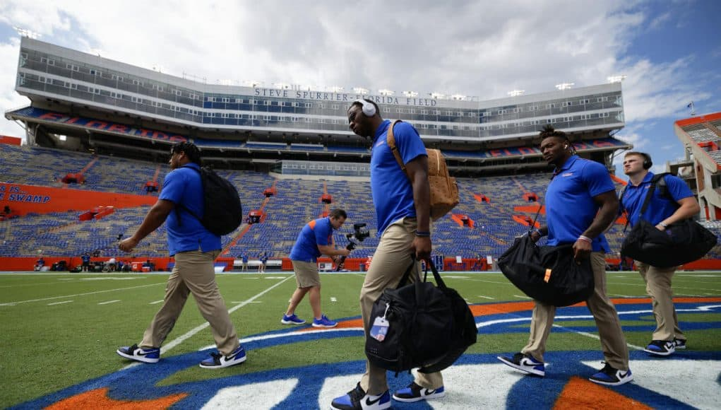 University of Florida players cross midfield during Gator walk before playing the Towson Tigers- Florida Gators football- 1280x853