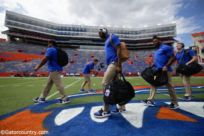 University of Florida players cross midfield during Gator walk before playing the Towson Tigers- Florida Gators football- 1280x853