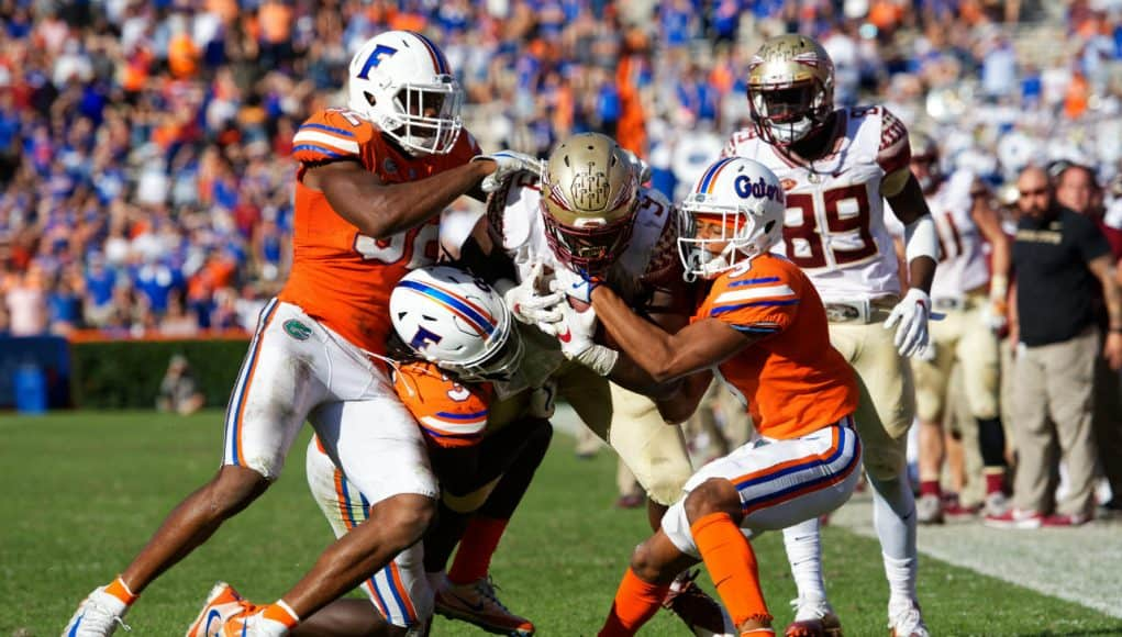 University of Florida Gators defensive back Shawn Davis cornerback Marco Wilson combine for a tackle in a loss to FSU- Florida Gators football- 1280x853
