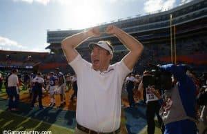 University of Florida head coach Dan Mullen celebrates with fans after the Florida Gators 56-0 win over Vanderbilt- Florida Gators football- 1280x853