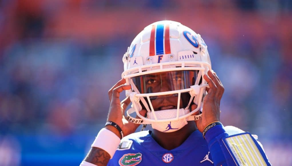 University of Florida quarterback Emory Jones puts his helmet on before entering the game against Vanderbilt- Florida Gators football- 1280x853