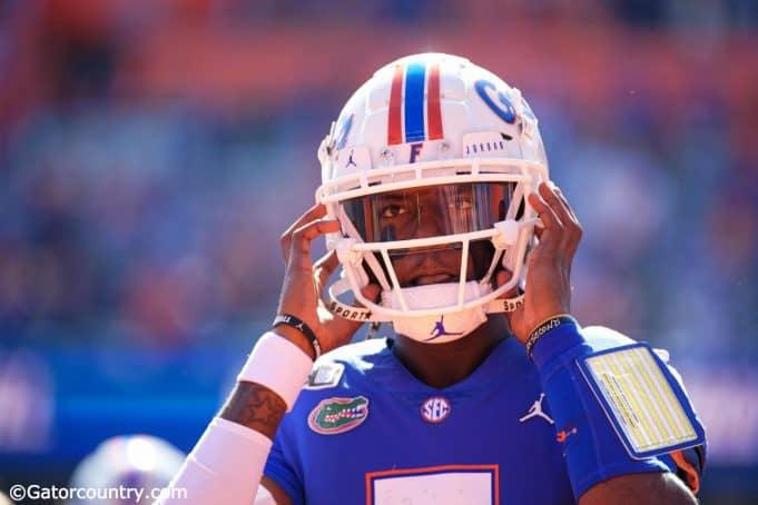 University of Florida quarterback Emory Jones puts his helmet on before entering the game against Vanderbilt- Florida Gators football- 1280x853
