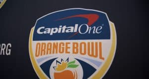 The Orange Bowl logo on a backdrop before the Florida Gators football team is interviewed before the 2019 Orange bowl- Florida Gators football- 1280x854