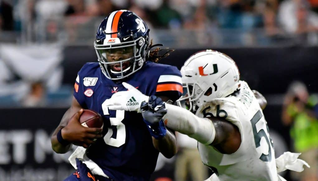 Oct 11, 2019; Miami Gardens, FL, USA; Virginia Cavaliers quarterback Bryce Perkins (3) is tackled by Miami Hurricanes linebacker Michael Pinckney (56) during the second half at Hard Rock Stadium. Mandatory Credit: Steve Mitchell-USA TODAY Sports