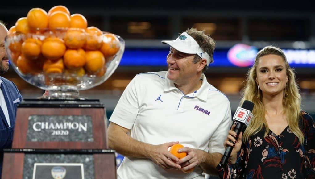University of Florida head coach Dan Mullen accepts the orange Bowl trophy after the Gators' win over Virginia- Florida Gators football- 1280x852