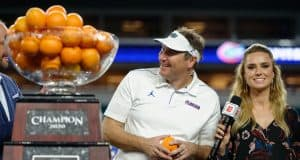 University of Florida head coach Dan Mullen accepts the orange Bowl trophy after the Gators' win over Virginia- Florida Gators football- 1280x852