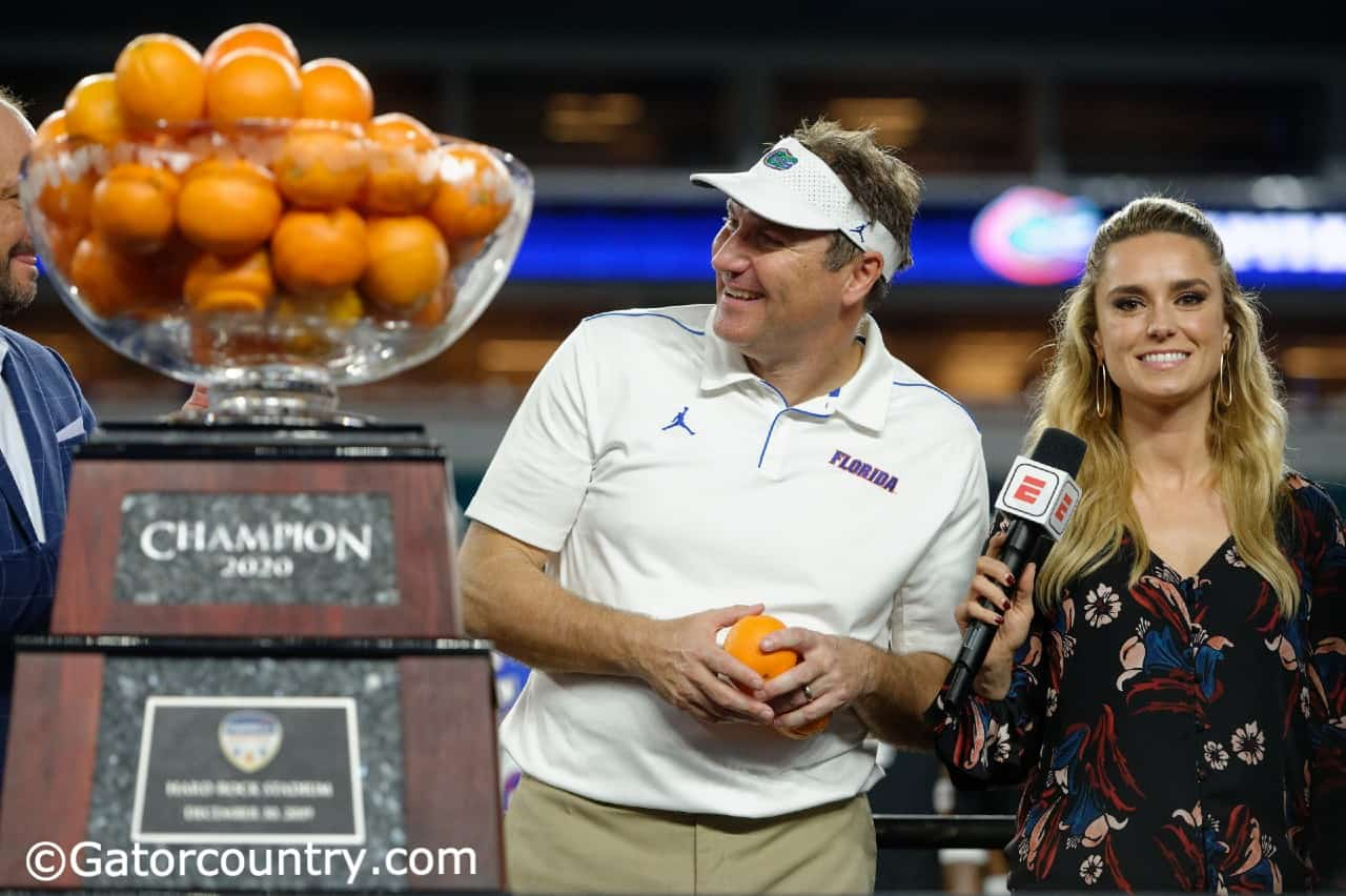 University-of-florida-head-coach-dan-mullen-accepts-the-orange-bowl-trophy-after-the-gators%e2%80%99-win-over-virginia-florida-gators-football-1280x852