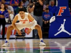 University of Florida guard Andrew Nembhard stretches before tipoff against Florida State- Florida Gators basketball- 1280x853
